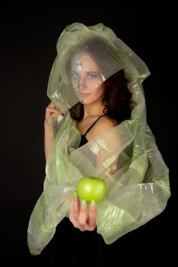 Two-faced woman with green apple tempt