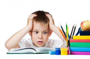 sad schoolboy doing is homework