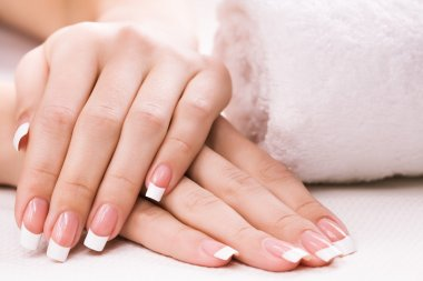 Female hands with towel. Spa