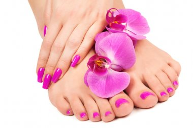 pink manicure and pedicure with a orchid flower.