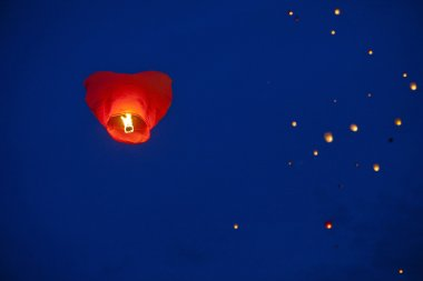 Heart-shaped chinese lantern in the night sky