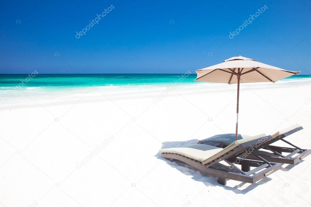 Umbrella on a perfect white sand Tulum beach in Mexico