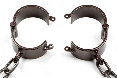 old style medieval handcuffs made of heavy iron