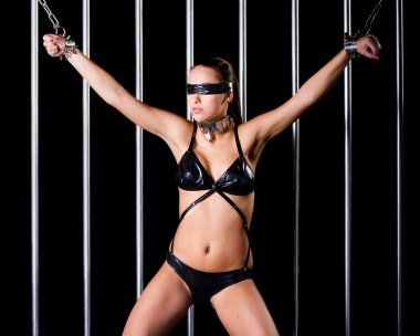 bondage style with a sexy woman dressed in lingerie