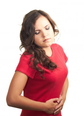 Attractive girl in red shirt is suffering from abdominal pain.