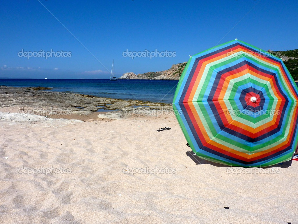 beach parasol on the seashore in capo testa sardinia stock photo lifeinapixel 50153311. Black Bedroom Furniture Sets. Home Design Ideas
