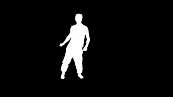 Silhouette of a young man breakdancing