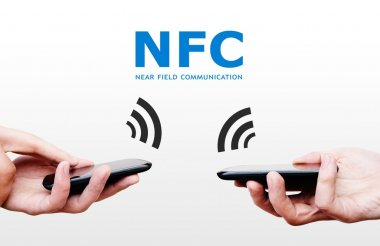 Two mobile phones with NFC payment technology. Near field commun