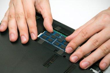 Man installing memory. Laptop RAM upgrade