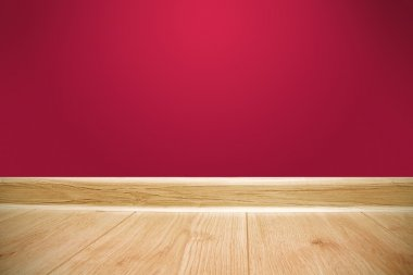Red wall and wooden floor background
