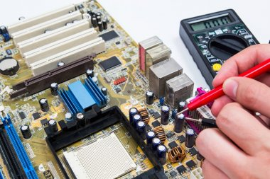 Motherboard measure. Man repairing computer hardware