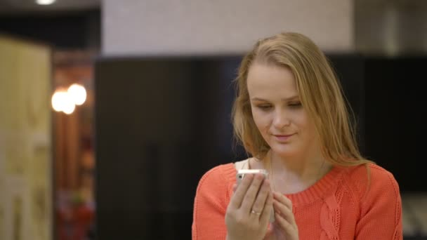 Young woman using smartphone.