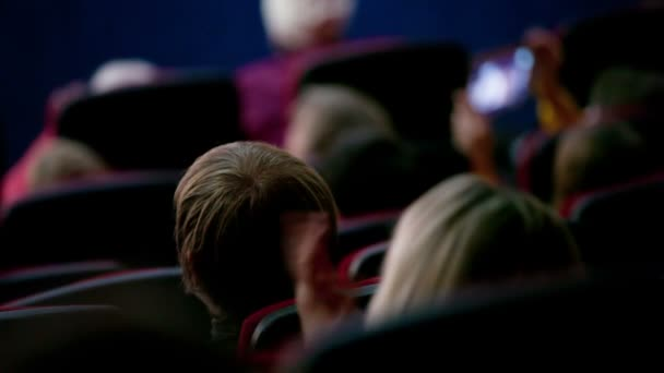 People applaud in the movie theater