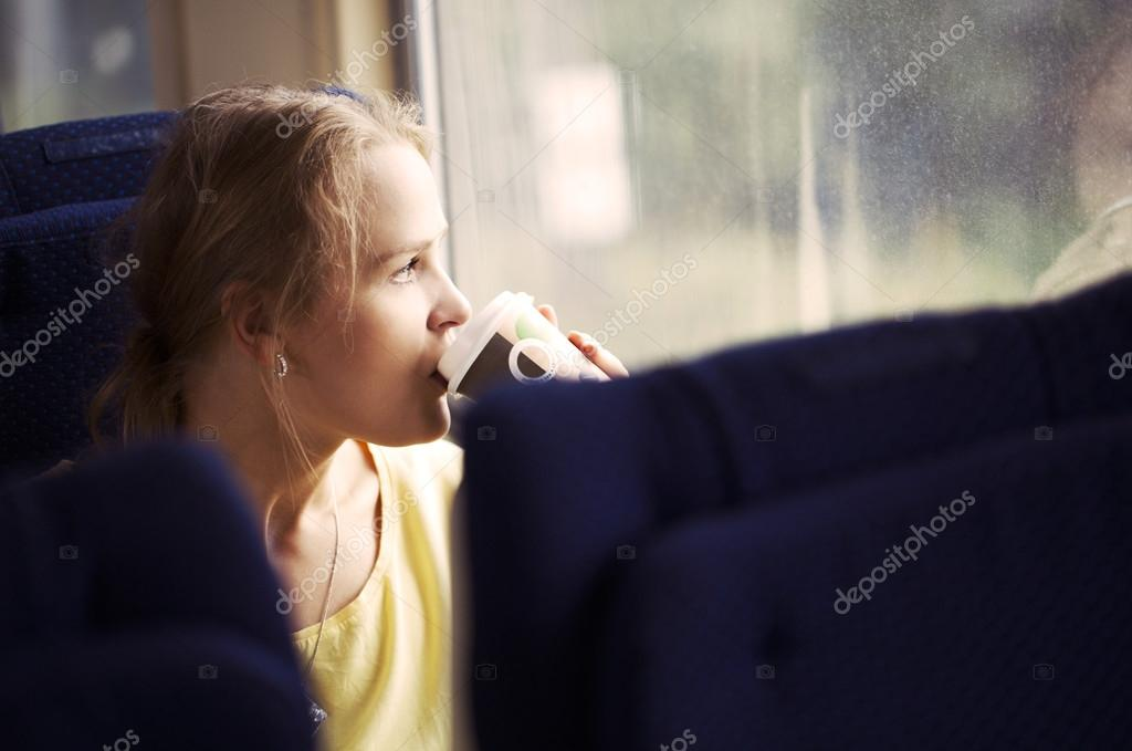 Pensive woman traveling by train