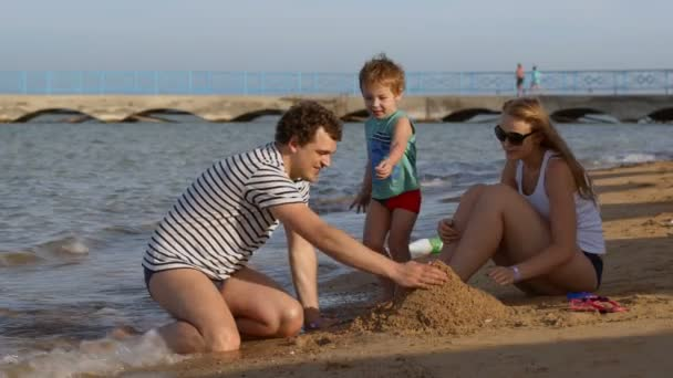 Family making a sandcastle