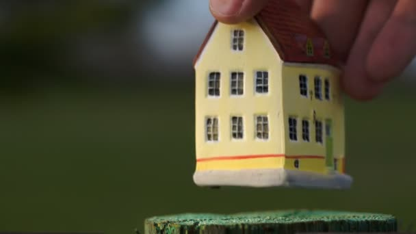 Putting a toy house on small stub