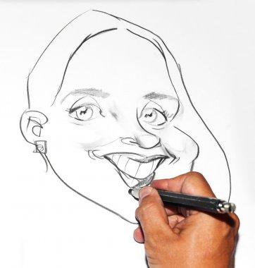 Human hand drawing a cartoon woman
