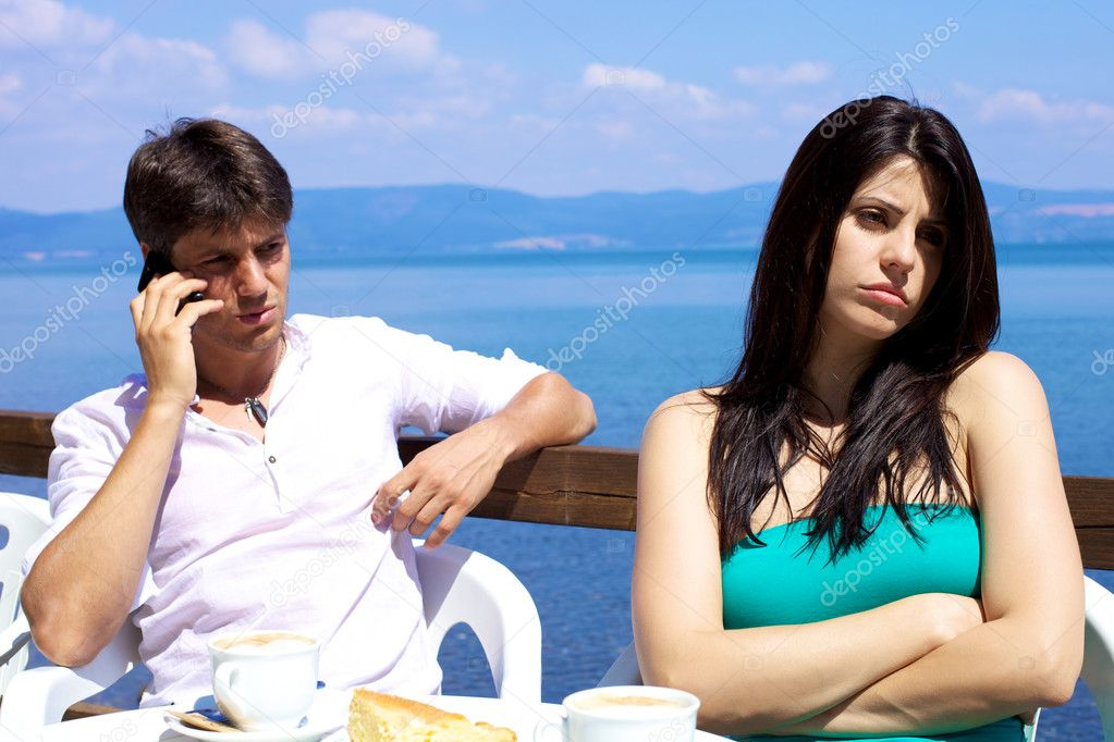 Beautiful woman upset with boyfriend talking with cell phone