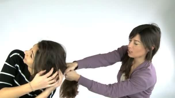 Woman pulling hair fighting friend