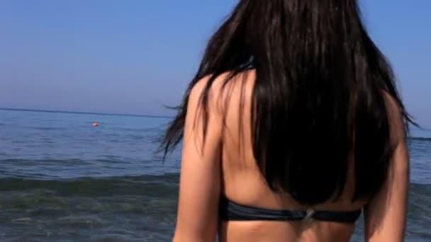 Model walking in the ocean