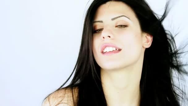 Female model drying long silky hair