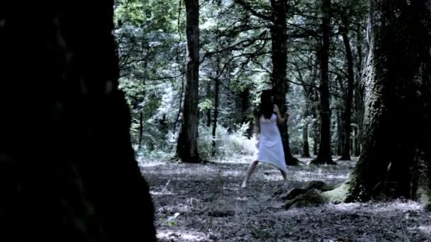 Woman scared running in forest