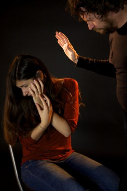 Man hitting in face young woman