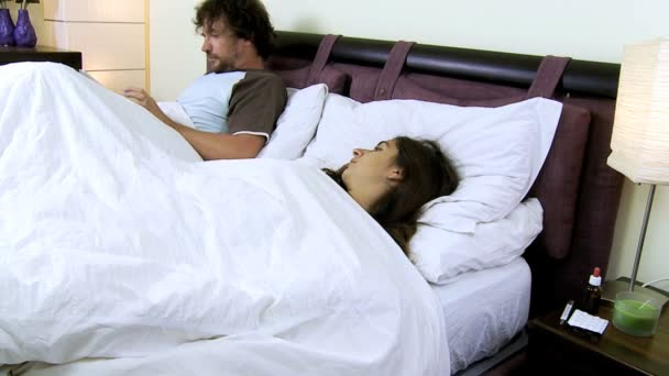 Wife with husband in bed