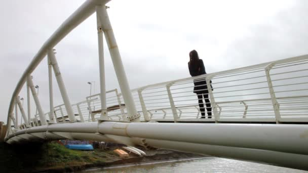 Woman crying on a bridge