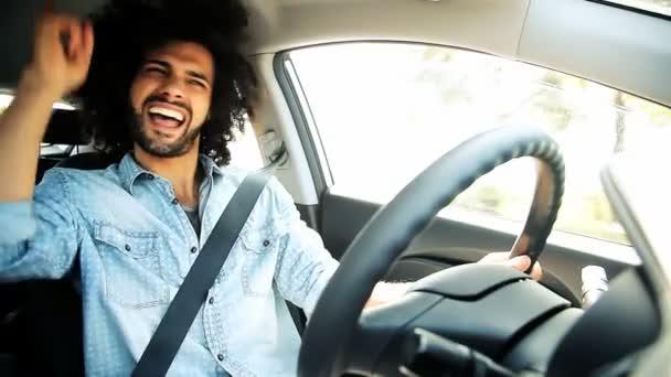 Man singing while driving car