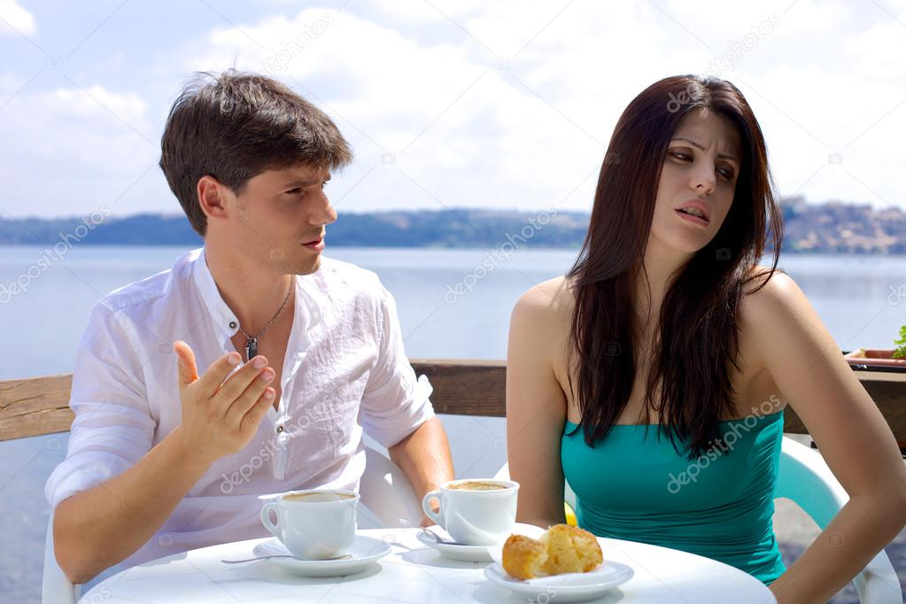 Couple fighting in vacation during breakfast on lake