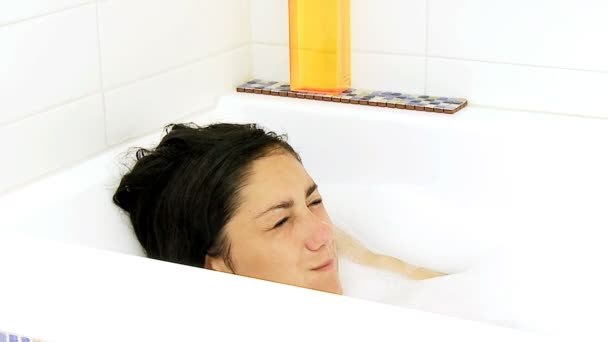 Woman playing in bath tub