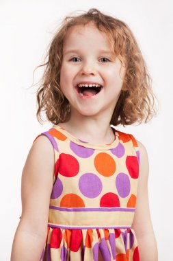 Happy little girl in a bright dress