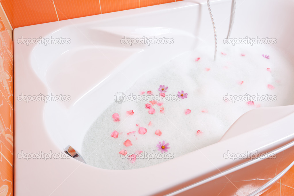 Bubble bath with flowers — Stock Photo © alexhg1 #13748181
