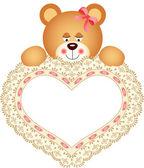 Medvídek držící vyšívané srdce