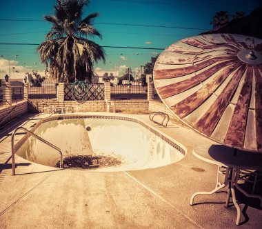 Derelict road side motel swimming pool American south west
