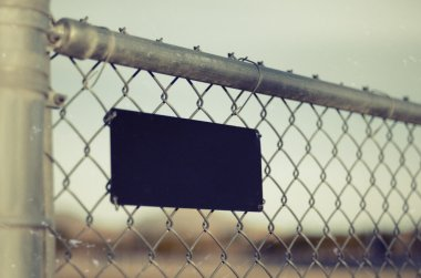 Chainlink chain link metal fence with sign
