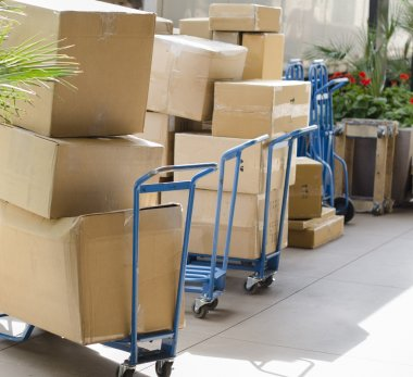 Delivering cargo boxes from truck to business