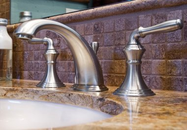 Modern faucet tap and granite counter