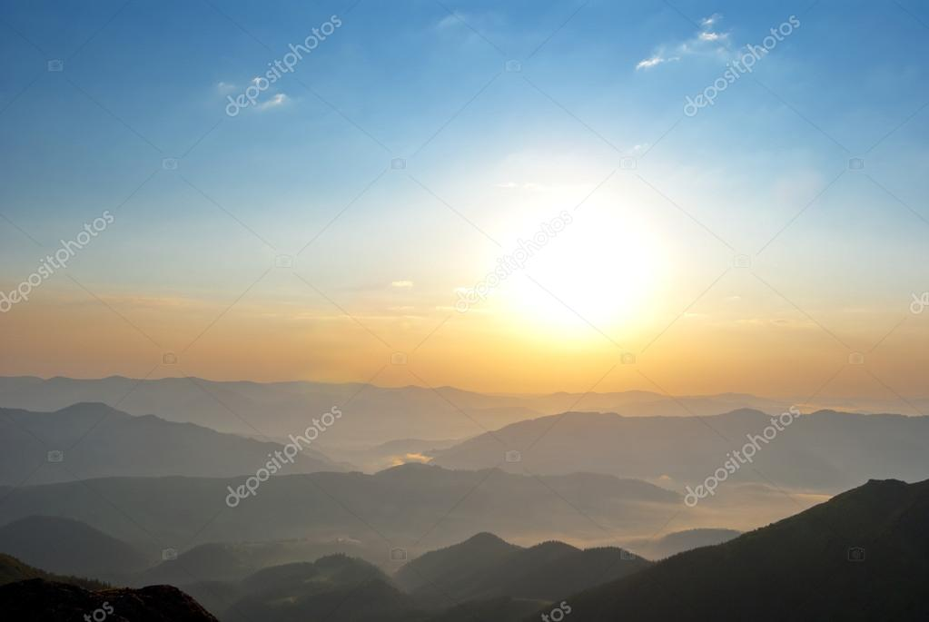 sunrise over a mountain valley
