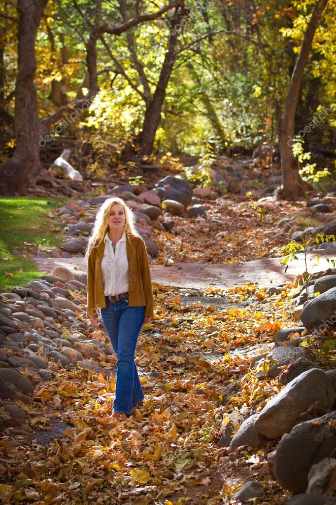 Pretty Woman in Autumn leaves