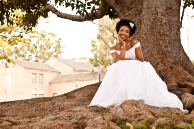 Beautiful African American Bride under an oak tree