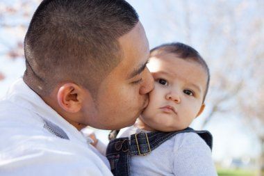 Young Father Kissing his son