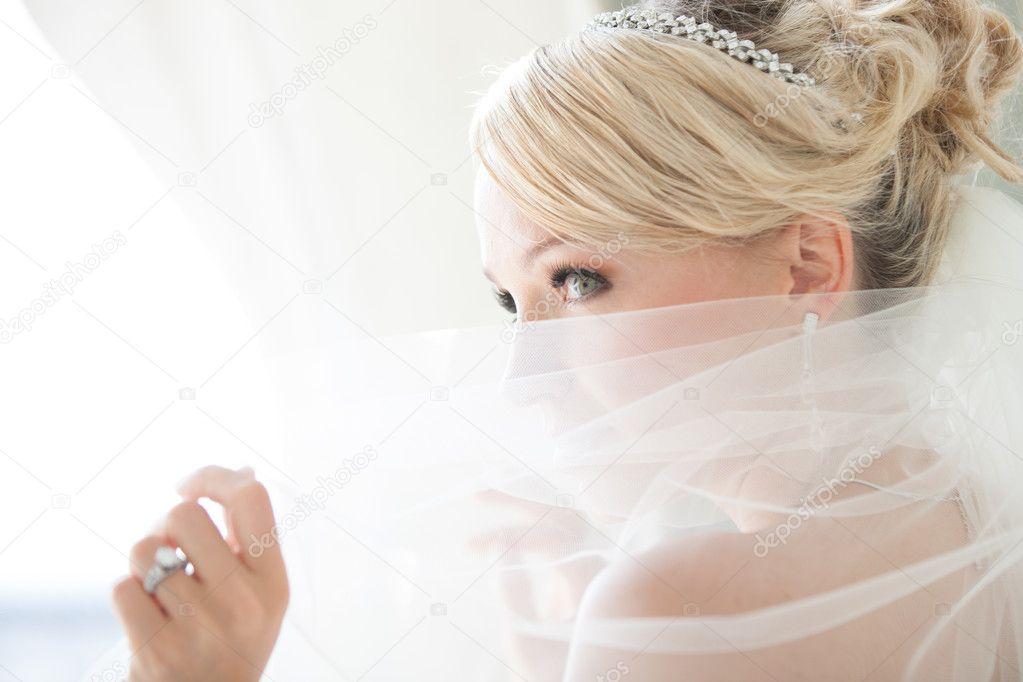 Beautiful Bride Peaking over her Vwil