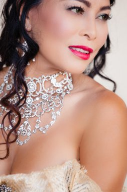 Beautiful woman with elaborate Jewelry