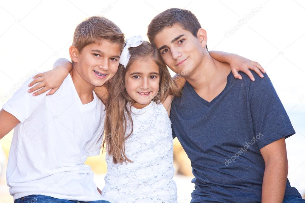 Family at the beach posing