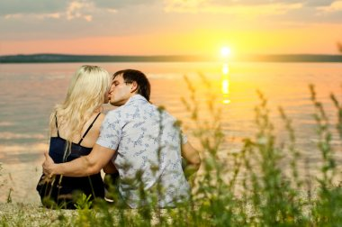 Horizontal photo the happy couple, outdoor on sunset or sunrise stock vector