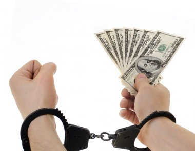 Hand   in shackle hold dollars