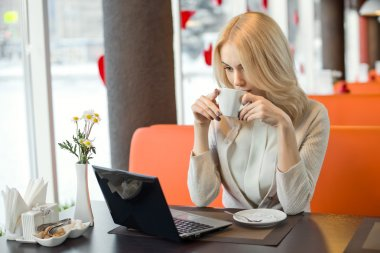 Young woman in Cafe with laptop