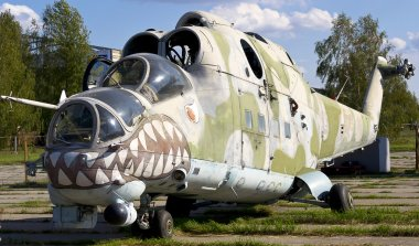 Old Soviet military helicopter MI-24 with bullet prints on glas